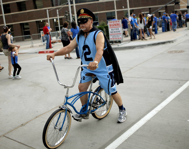 A fan rides past the Oklahoma City Arena before game 4 of the Western Conference Finals in the NBA basketball playoffs between the Dallas Mavericks and the Oklahoma City Thunder at the Oklahoma City Arena in downtown Oklahoma City, Monday, May 23, 2011. Photo by Bryan Terry, The Oklahoman