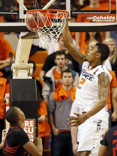 Oklahoma State&#039;s Le&#039;Bryan Nash (2) dunks the ball during a men&#039;s college basketball game between Oklahoma State University (OSU) and Texas Tech at Gallagher-Iba Arena in Stillwater, Okla., Saturday, Jan. 19, 2013.  Photo by Nate Billings, The Oklahoman