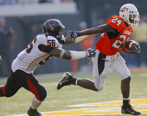 Oklahoma State's Kendall Hunter gets past Texas Tech's Kellen Tillman (56) during the second half of the college football game between the Oklahoma State University Cowboys (OSU) and the Texas Tech University Red Raiders (TTU) at Boone Pickens Stadium  on Saturday, Sept. 22, 2007, in Stillwater, Okla. 