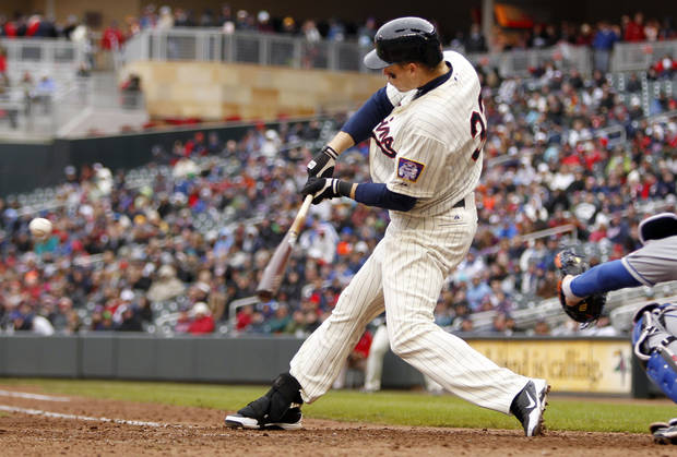 Minnesota Twins' Justin Morneau (33) hits a solo home run against New York Mets starting pitcher Matt Harvey during the seventh inning of a baseball game Saturday, April 13, 2013, in Minneapolis. The Mets won 4-2. (AP Photo/Genevieve Ross)