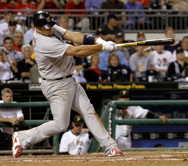 St. Louis Cardinals' Albert Pujols hits a line drive single to left field in the sixth in the inning of the baseball game against the Pittsburgh Pirates in Pittsburgh,  Monday, Aug. 23, 2010. Pujols went 3 for 5 with a three-run homer, a double and a single.The Cards won 10-2. (AP Photo/Keith Srakocic) ORG XMIT: PAKS109