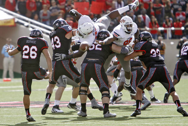 Oklahoma State Cowboys defensive tackle Nigel Nicholas (89) and Davidell Collins (98) tries to block a punt by Ryan Erxleben (26) during the college football game between the Oklahoma State University Cowboys (OSU) and Texas Tech University Red Raiders (TTU) at Jones AT&T Stadium on Saturday, Nov. 12, 2011. in Lubbock, Texas.  Photo by Chris Landsberger, The Oklahoman  ORG XMIT: KOD