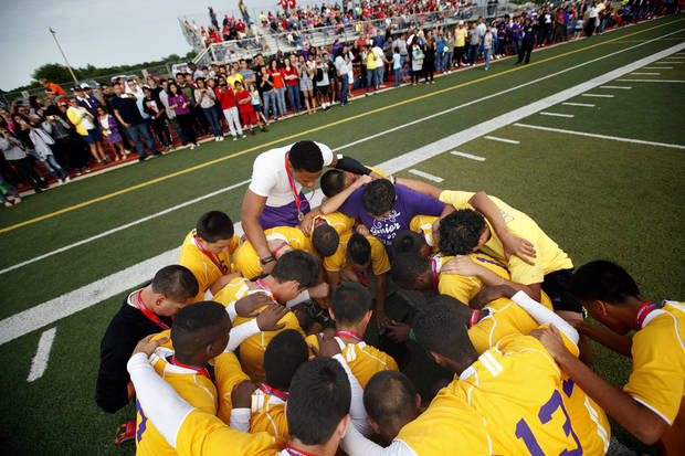 Northwest Classen prays in front of their fans after winning the boys 5A soccer state championship game over Cascia Hall at Edmond North High School in Edmond, Okla., Saturday, May 12, 2012. Photo by Sarah Phipps, The Oklahoman