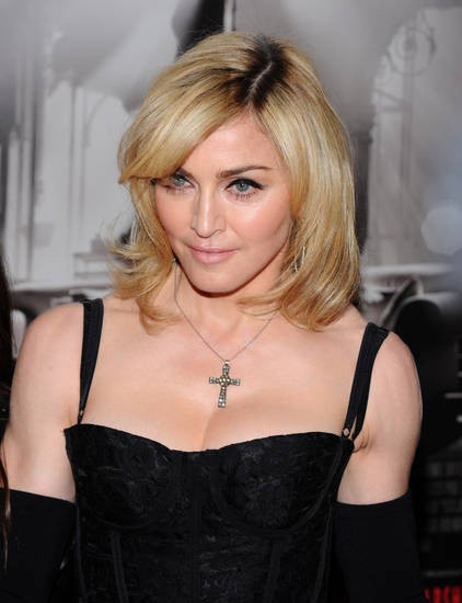 FILE- This Dec. 15, 2009 file photo shows singer Madonna attending the premiere of &quot;Nine&quot; at the Ziegfeld Theatre in New York. The pop star has announced a $250,000 donation to Haiti. (AP Photo/Peter Kramer,File) ORG XMIT: NYET578