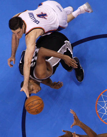 Oklahoma City's Nick Collison (4) reaches over San Antonio's Boris Diaw (33) during Game 4 of the Western Conference Finals between the Oklahoma City Thunder and the San Antonio Spurs in the NBA playoffs at the Chesapeake Energy Arena in Oklahoma City, Saturday, June 2, 2012. Oklahoma CIty won 109-103. Photo by Bryan Terry, The Oklahoman