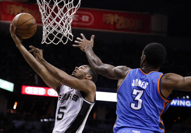 San Antonio's Cory Joseph (5) shoots a lay up as Oklahoma City's Perry Jones (3) defends during Game 2 of the Western Conference Finals in the NBA playoffs between the Oklahoma City Thunder and the San Antonio Spurs at the AT&T Center in San Antonio, Wednesday, May 21, 2014. Photo by Sarah Phipps