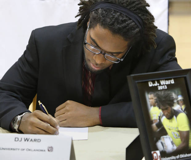 D. J. Ward signs a letter of intent to play football at the University of Oklahoma.  More than a dozen Southmoore High School athletes signed letters of intent to play at various colleges and universities  during an afternoon signing ceremony  in the school&#039;s gymnasium on Wednesday, Feb. 6, 2013.  Photo by Jim Beckel, The Oklahoman