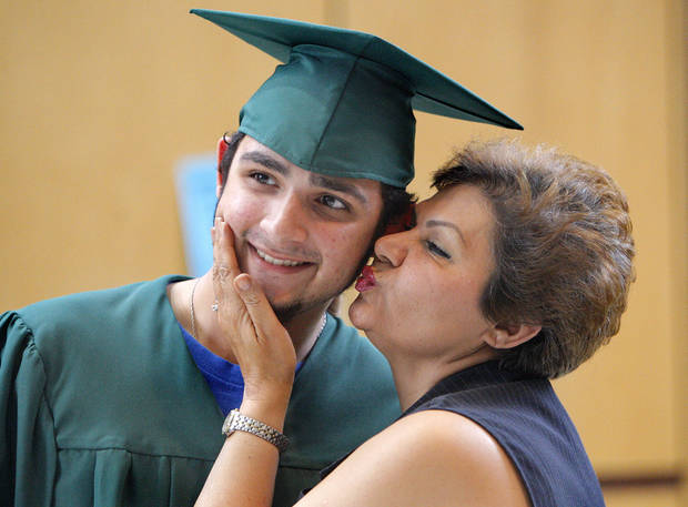 Simin Goli kisses her son Babak Goli as he poses for a picture after picking up his graduation robe at Edmond Santa Fe High School in Edmond, Okla., Thursday, May 10, 2012. Photo by Sarah Phipps, The Oklahoman