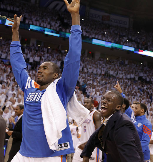 Serge Ibaka and Reggie Jackson celebrate during Game 6 of the Western Conference Finals between the Oklahoma City Thunder and the San Antonio Spurs in the NBA playoffs at the Chesapeake Energy Arena in Oklahoma City, Wednesday, June 6, 2012. Photo by Chris Landsberger, The Oklahoman