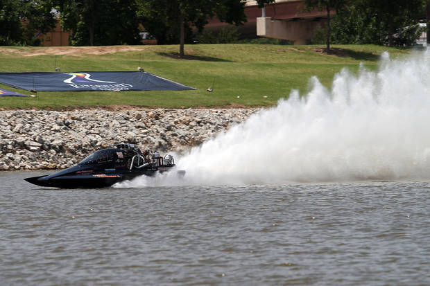 Jimmy Parsons of Blanchard races down the course during the Oklahoma City Nationals Drag Boat races on the Oklahoma River Saturday, June 9th, 2012. PHOTO BY HUGH SCOTT, FOR THE OKLAHOMAN    ORG XMIT: KOD