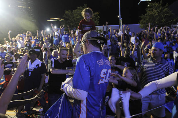 Fans cheer for shirts at Love's Thunder Alley, Monday, April 30, 2012.  Photo by Garett Fisbeck, For The Oklahoman