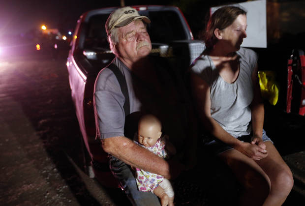 Michael Bowen waits with his wife outside a mobile home park that was struck by a tornado at Bethel Acres , Okla., Sunday, May 19, 2013. Photo by Sarah Phipps, The Oklahoman