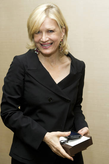 FILE - In this March 24, 2012 photo, Diane Sawyer attends Aretha Franklin's seventieth birthday party in New York. Sawyer�s Election Night performance left some viewers asking if she had begun celebrating Tuesday's election a bit early. (AP Photo/Charles Sykes, File)