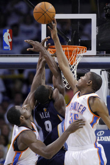 Oklahoma City's Serge Ibaka (9) and Kevin Durant (35) defend against Tony Allen (9) of Memphis during game five of the Western Conference semifinals between the Memphis Grizzlies and the Oklahoma City Thunder in the NBA basketball playoffs at Oklahoma City Arena in Oklahoma City, Wednesday, May 11, 2011. Photo by Sarah Phipps, The Oklahoman