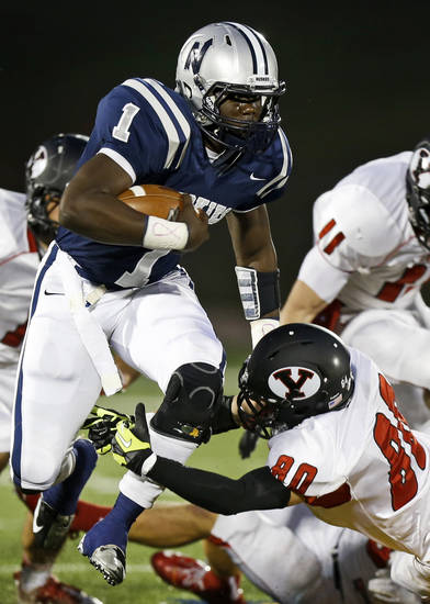 Edmond North's Michael Farmer tries to leap past Yukon's Zayne Nave during their high school football game at Wantland Stadium in Edmond, Okla., Thursday, October 4, 2012. Photo by Bryan Terry, The Oklahoman