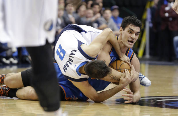 Oklahoma City Thunder center Steven Adams and Dallas Mavericks guard Jose Calderon (8) of Spain tussle for the ball during the first half of an NBA basketball game Tuesday, March 25, 2014, in Dallas. (AP Photo/LM Otero)