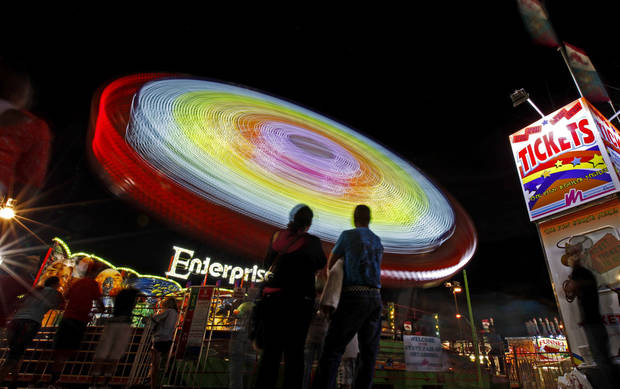 A ride spins patrons around after sunset at the Oklahoma State Fair in Oklahoma City, Wednesday, September 19, 2012. Photo by Bryan Terry, The Oklahoman