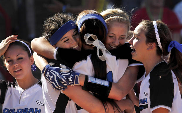Alex Edinger, bow in hair and back to camera, is hugged by jubilant teammates after they blanked Piedmont in six innings. Class 4A high school championship softball game between Oologah and Piedmont at Hall of Fame Stadium in Oklahoma City on Saturday, Oct. 15, 2012.  Oologah won the game in the bottom of the sixth inning when Baleigh Hamilton scored the winning run on a hit by Alex Edinger, allowing them to claim the victory by virtue of the the run rule, defeating Piedmont,  10-0.    Photo by Jim Beckel, The Oklahoman