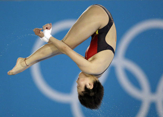 Chen Ruolin competes during the women's 10-meter platform diving semifinal at the Aquatics Centre in the Olympic Park during the 2012 Summer Olympics in London, Thursday, Aug. 9, 2012. (AP Photo/Michael Sohn)