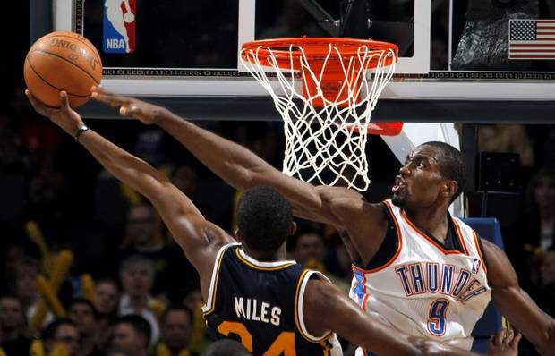 Oklahoma City's Serge Ibaka (9) blocks Utah's Paul Millsap (24) shot during the NBA basketball game between the Oklahoma City Thunder and Utah Jazz, Wednesday, March 23, 2011, at the Oklahoma City Arena. Photo by Sarah Phipps, The Oklahoman ORG XMIT: KOD