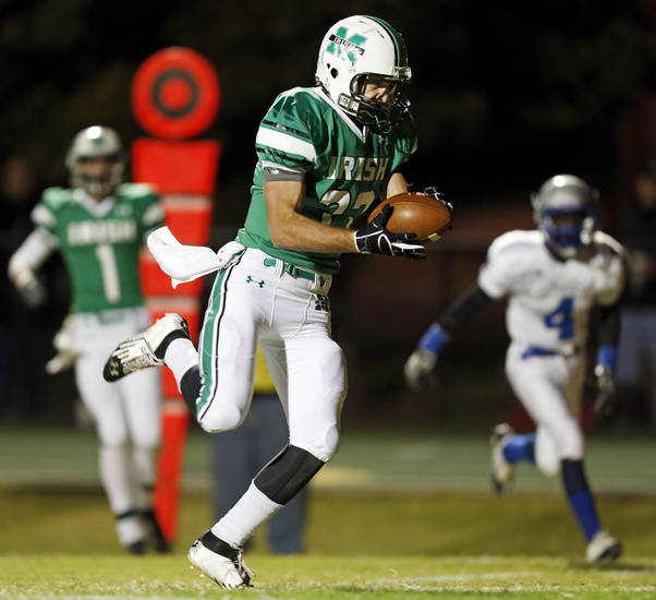Danny Krenger (33) of Bishop McGuinness catches a touchdown pass in the first quarter during a high school football game between Bishop McGuinness and Guthrie at Bishop McGuinness Catholic High School in Oklahoma City, Friday, Oct. 26, 2012. Photo by Nate Billings, The Oklahoman