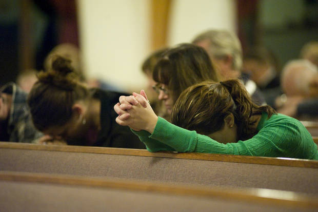 People pray at Mountainside Assembly of God Church in Coal Township, Pa., during a interfaith prayer vigil, Sunday, Dec. 16, 2012, for the victims of Newtown, Conn. Twenty-six people, including 20 children, were killed in Friday's shooting rampage at Sandy Hook Elementary School. (AP Photo/The News-Item, Larry Deklinski) ORG XMIT: PASHA101