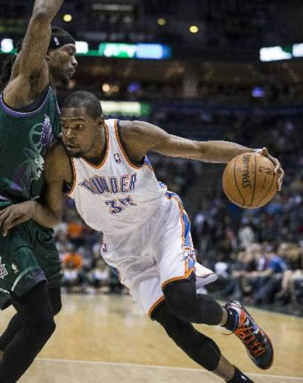 Oklahoma City Thunder's Kevin Durant, right, drives past Milwaukee Bucks' Marquis Daniels during the first half of an NBA basketball game on Saturday, March 30, 2013, in Milwaukee. (AP file)