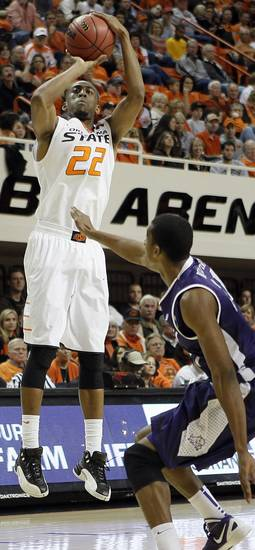 Oklahoma State&#039;s Markel Brown (22) shoots over TCU&#039;s Nate Butler Lind (21) during the college basketball game between Oklahoma State University Cowboys (OSU) and Texas Christian University Horned Frogs (TCU) at Gallagher-Iba Arena on Wednesday Jan. 9, 2013, in Stillwater, Okla. 