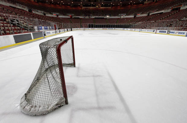 In this photo taken Tuesday, Dec. 18, 2012, a hockey goal sits on the ice at Joe Louis Arena home of the Detroit Red Wings hockey club in Detroit. The NHL lockout that's already wiped out the first three months of the season is taking its toll on small businesses in many of the NHL's markets. (AP Photo/Paul Sancya, File)