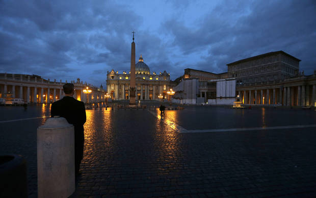 A man stands in St. Peter's Square at the Vatican, early Tuesday, Feb. 12, 2013. Declaring that he lacks the strength to do his job, Pope Benedict XVI announced Monday, Feb. 11, 2013 he will resign Feb. 28, becoming the first pontiff to step down in 600 years. His decision sets the stage for a mid-March conclave to elect a new leader for a Roman Catholic Church in deep turmoil. (AP Photo/Alessandra Tarantino)