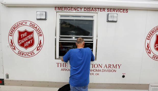 Ken Wedel gets lunch from the Salvation Army in Oklahoma City, Thursday May 23, 2013. Ken's home on Sylena Way was damaged by the massive tornado that hit Monday.Photo By Steve Gooch, The Oklahoman