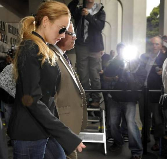Lindsay  Lohan exits a probation violation hearing at Beverly Hills Courthouse in Beverly Hills, Calif., Friday, Oct. 22, 2010. (AP Photo/Chris Pizzello)