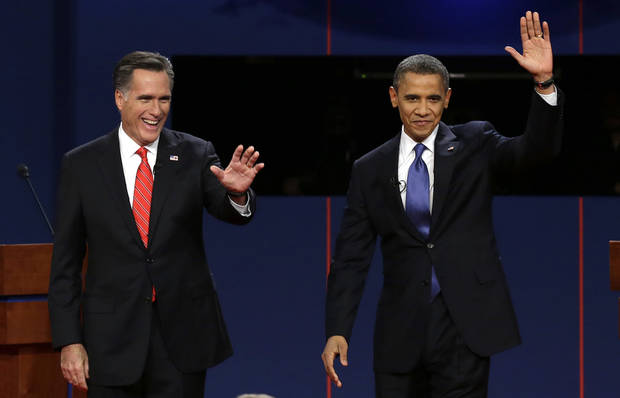 Republican presidential nominee Mitt Romney and President Barack Obama wave to the audience during the first presidential debate at the University of Denver, Wednesday, Oct. 3, 2012, in Denver. (AP Photo/Charlie Neibergall)