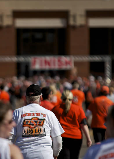 A pack of runners go towards the finish line in the Remember the Ten run held in Stillwater, Okla., on April 21, 2012. Photos by Mitchell Alcala for the Oklahoman  ORG XMIT: KOD