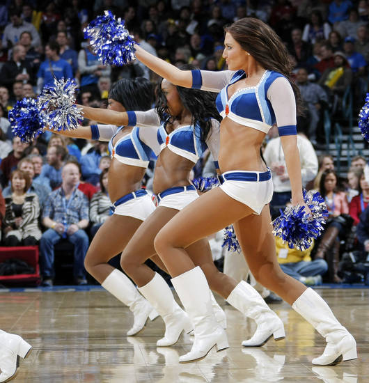 The Thunder Girls dance team perform during the NBA basketball game between the Orlando Magic and Oklahoma City Thunder in Oklahoma City, Thursday, January 13, 2011. Photo by Nate Billings, The Oklahoman