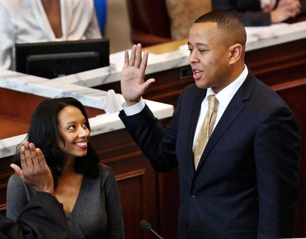 T.W. Shannon is sworn in as Speaker of the House. At his side is his wife, Devon. Shannon was elected by his colleagues in the Oklahoma House of Representatives as their Speaker for the upcoming legislative session. Shannon, a Republican from Lawton, is Oklahoma's first black Speaker of the House. He was sworn in on the floor of the House by Oklahoma Supreme Court Chief Justice Tom Colbert on Tuesday, Jan. 8, 2013.  Colbert became  Oklahoma's first black chief justice when he was sworn in last week.    Photo by Jim Beckel, The Oklahoman
