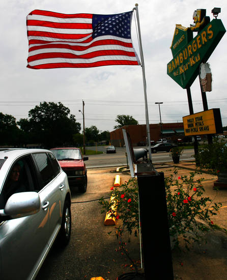 ROUTE 66:  Ann Neal places an order at the drive-thru of Waylin's the Ku-Ku restaurant in Miami, Okla., on Monday, June 18, 2007. By James Plumlee, The Oklahoman.
