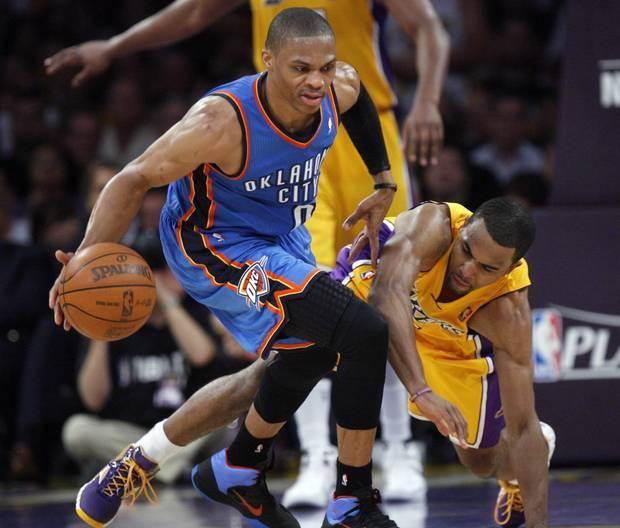Oklahoma City's Russell Westbrook (0) tracks down a loose ball as Los Angeles' Matt Barnes (9) defends during Game 4 in the second round of the NBA basketball playoffs between the L.A. Lakers and the Oklahoma City Thunder at the Staples Center in Los Angeles, Saturday, May 19, 2012. Photo by Nate Billings, The Oklahoman