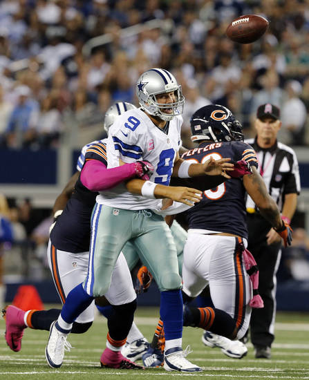 Dallas Cowboys quarterback Tony Romo (9) is sacked by Chicago Bears defensive tackle Henry Melton (69) during the second half an NFL football game Monday, Oct. 1, 2012, in Arlington, Texas. The Bears won 34-18. (AP Photo/The Waco Tribune-Herald, Jose Yau)