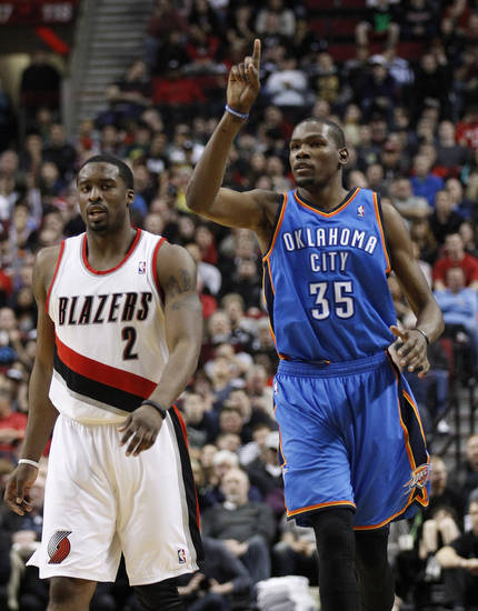Oklahoma City Thunder's Kevin Durant (35) points skyward after scoring over Portland Trail Blazers' Wesley Matthews (2) in the second quarter of an NBA basketball game, Tuesday, March 27, 2012, in Portland, Ore. (AP Photo/Rick Bowmer)