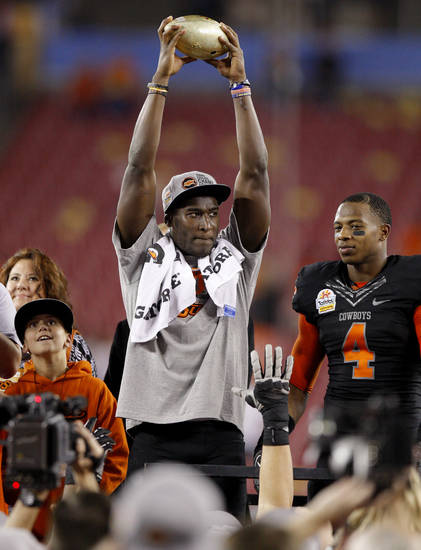 Oklahoma State&#039;s Justin Blackmon holds up the Fiesta Bowl trophy beside Justin Gilbert after winning the Fiesta Bowl between the Oklahoma State University Cowboys (OSU) and the Stanford Cardinal at the University of Phoenix Stadium in Glendale, Ariz., Tuesday, Jan. 3, 2012. Photo by Bryan Terry, The Oklahoman
