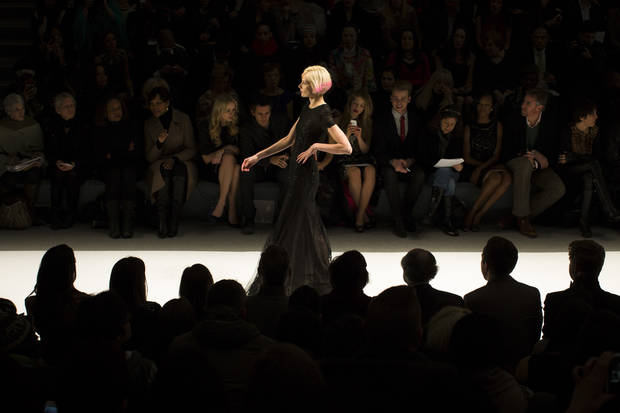 A model walks the runway at the presentation of the Carmen Marc Valvo Fall 2013 fashion collection during Fashion Week, Thursday, Feb. 7, 2013, in New York. (AP Photo/John Minchillo)