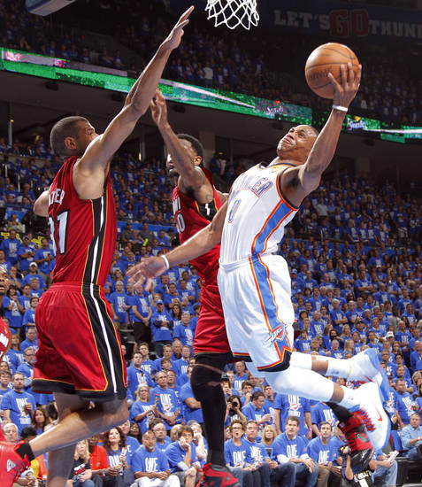 Oklahoma City's Russell Westbrook (0) goes around Miami's Shane Battier (31) and Miami's Udonis Haslem (40) during Game 1 of the NBA Finals between the Oklahoma City Thunder and the Miami Heat at Chesapeake Energy Arena in Oklahoma City, Tuesday, June 12, 2012. Photo by Chris Landsberger, The Oklahoman