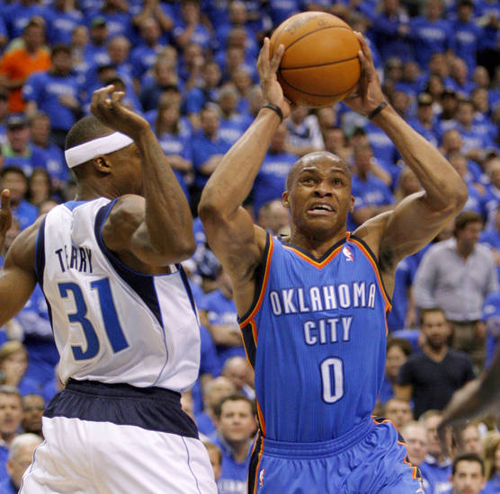 Oklahoma City's Russell Westbrook (0) tries to get around Dallas' Jason Terry (31) during Game 3 of the first round in the NBA playoffs between the Oklahoma City Thunder and the Dallas Mavericks at American Airlines Center in Dallas, Thursday, May 3, 2012. Photo by Bryan Terry, The Oklahoman