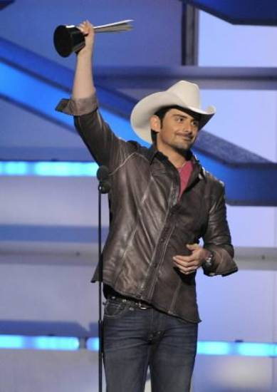 Brad Paisley accepts the top male vocalist award at the 2008 ACM Awards in this photo. Paisley won the award again this year. (Associated Press photo)