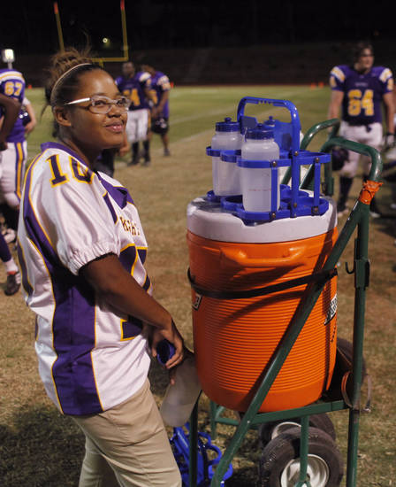 Filing the water bottles at the Northwest Classen vs. Western Heights high school football game at Taft Stadium Thursday, September 20, 2012. Photo by Doug Hoke, The Oklahoman