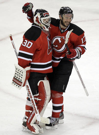 New Jersey Devils' Ilya Kovalchuk, right, of Russia, celebrates with goalie Martin Brodeur after beating the Philadelphia Flyers 4-2 in Game 4 of a second-round NHL hockey Stanley Cup playoff series, Sunday, May 6, 2012 in Newark, N.J. The Devils take a 3-1 lead in the series. (AP Photo/Julio Cortez)