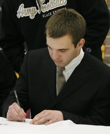 Hunter Frantz signs to play for Army at West Point during a signing ceremony at Putnam City North High School in Oklahoma City Wednesday, Feb. 4, 2009. BY PAUL B. SOUTHERLAND, THE OKLAHOMAN