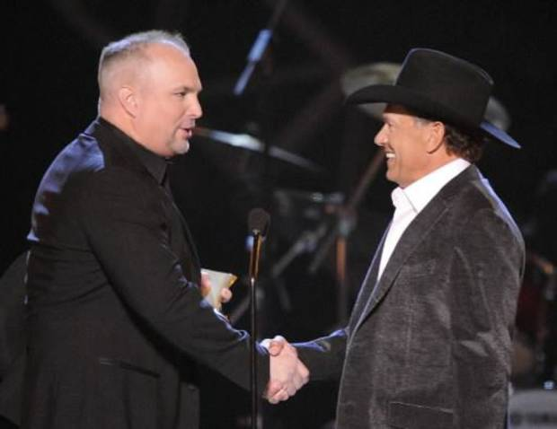This April 6, 2009 file photo shows musician Garth Brooks, left, presenting George Strait with the Artist of the Decade award at the ACM Artist of the Decade All Star Concert in Las Vegas. Brooks and Strait will perform together for a tribute to the late Dick Clark at the 48th Annual Academy of Country Music Awards on April 7, 2013 in Las Vegas. (AP)