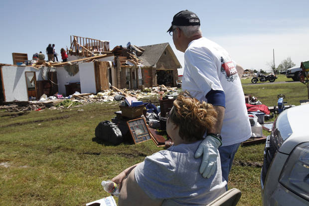 (Left) Bonnie Meritt of Union City, being consoled by a friend on Saturday, June 1, 2013 after the tornado outbreak in Canadian county on May 31, 2013 destroyed part of her house. Photo by Aliki Dyer, The Oklahoman